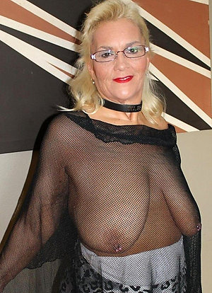 Crazy old lady with saggy boobs stripped