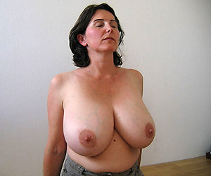 Horny busty nude mature