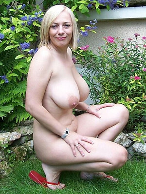 Sweet nude mature women outdoors photos