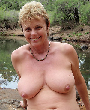 Amazing perfect mature tits posing nude