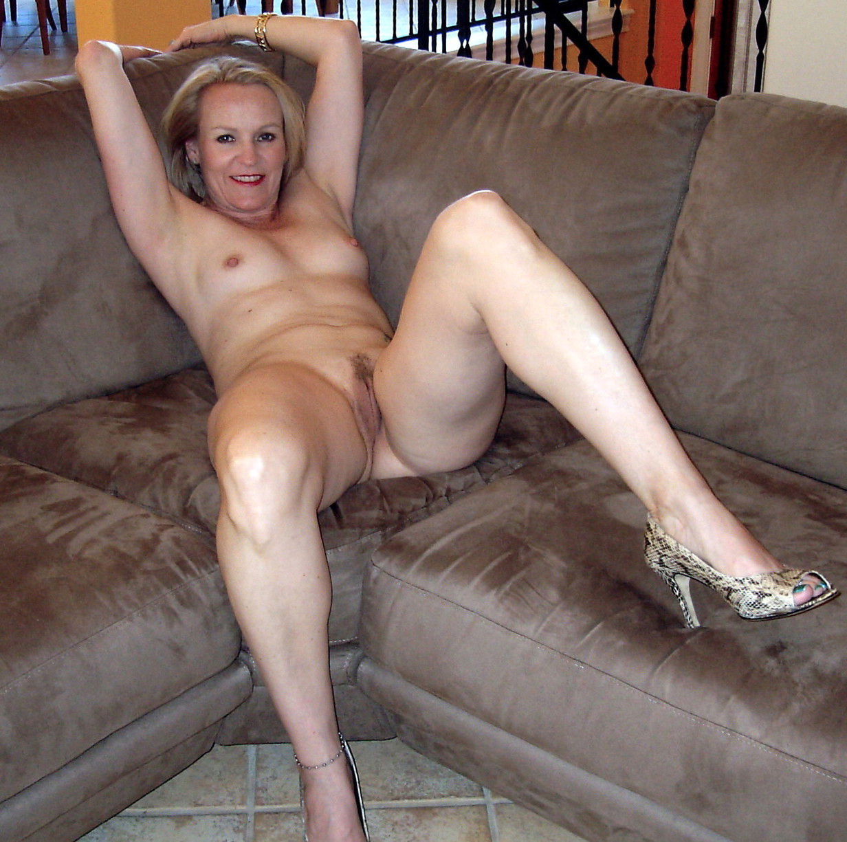 Naked Old Woman With Long Legs